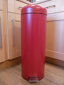 If you can't hide your kitchen bin, you may as well flaunt it.